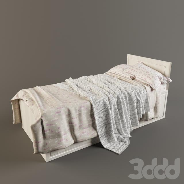 Кровать с вязанным пледом