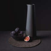 Black Tableware and Figs on Placemat