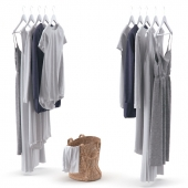 Clothes on hangers and linen basket