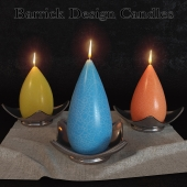A set of decorative candles from the company Barrick Design Candles
