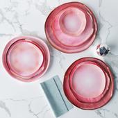 Set of plates in a pink glaze irregular shape