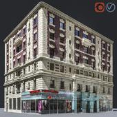 Угловой фасад старого здания на Манхэттене