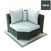 Haus Interior, Corner armchair made of woven rattan