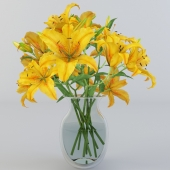 Yellow lily bouquet in glass vase