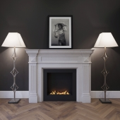 The fireplace is marble with a biotope, floor lamps and a picture.