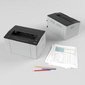 Лазерный принтер samsung SL-M2022 со стопкой бумаг