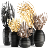 Collection of decorative vases with branches.