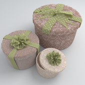 Set of round gift boxes with bows