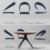 Table and chair with upholstery