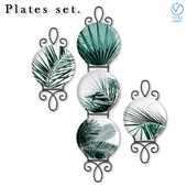 A set of decorative wall plates with palm branches.