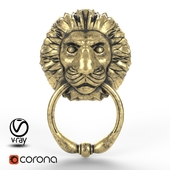 Door handle in the form of a lion's head with a ring