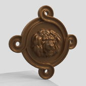 Барельеф головы льва