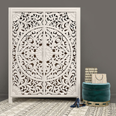 Carved Lombok Armoire with Velvet Carousel Ottoman pouf by Anthropologie