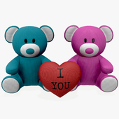 two teddy bear plush toys with heart