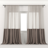 Velvet brown curtains with tulle.