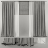 Gray curtains with tulle and roman blinds.