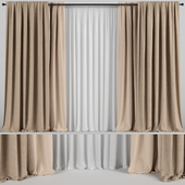 Wide brown curtains in two colors with tulle.