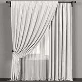 White curtains in the background with tulle.