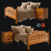 Wooden bed with linen