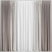 Светлые коричневые шторы с тюлем.