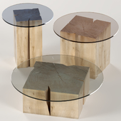 A set of square tables of stumps and slabs with glass tops.