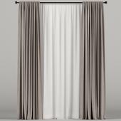 Коричневые узкие шторы с белым тюлем.