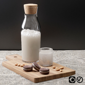 Almond milk with cup of milk and almonds cookies