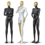 Three female mannequin with a golden face 41