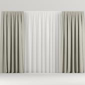 Wide beige curtains.
