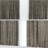 Wide brown velvet curtains with tulle.