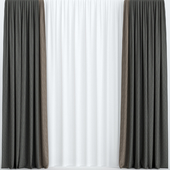 Dark curtains with tulle.