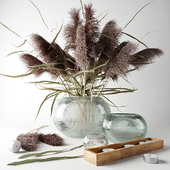 Bouquet of dry grass in a glass vase