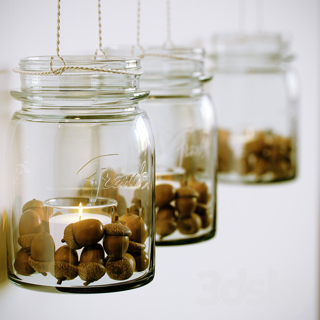 Decorative candle in a jar with acorns
