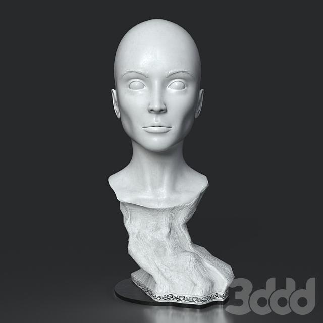 Статуэтка головы